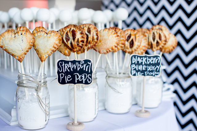 Lots of delicious pie pops displayed in mason jars with sugar