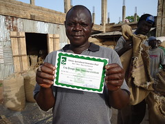 Large-scale farmer, Alhaji Alhassan Gunda Zakaria of the Gunda Producing Company in Tamale, northern Ghana holds up an agriculture insurance certificate from the Ghana Agriculture Insurance Programme. Credit: Albert Oppong-Ansah/IPS