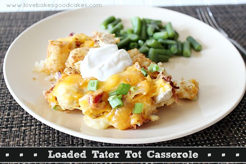 Loaded Tater Tot Casserole with green beans on white plate.