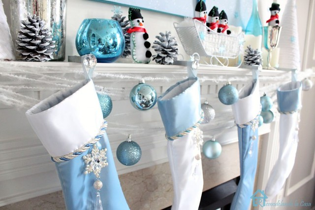 furniture-and-accessories-cute-snowy-christmas-fireplace-mantel-decoration-in-white-and-blue-with-cool-snowman-ornaments-shiny-balls-snowy-pine-cones-and-lovely-hanging-stockings-welcome-santa-lov-775x516