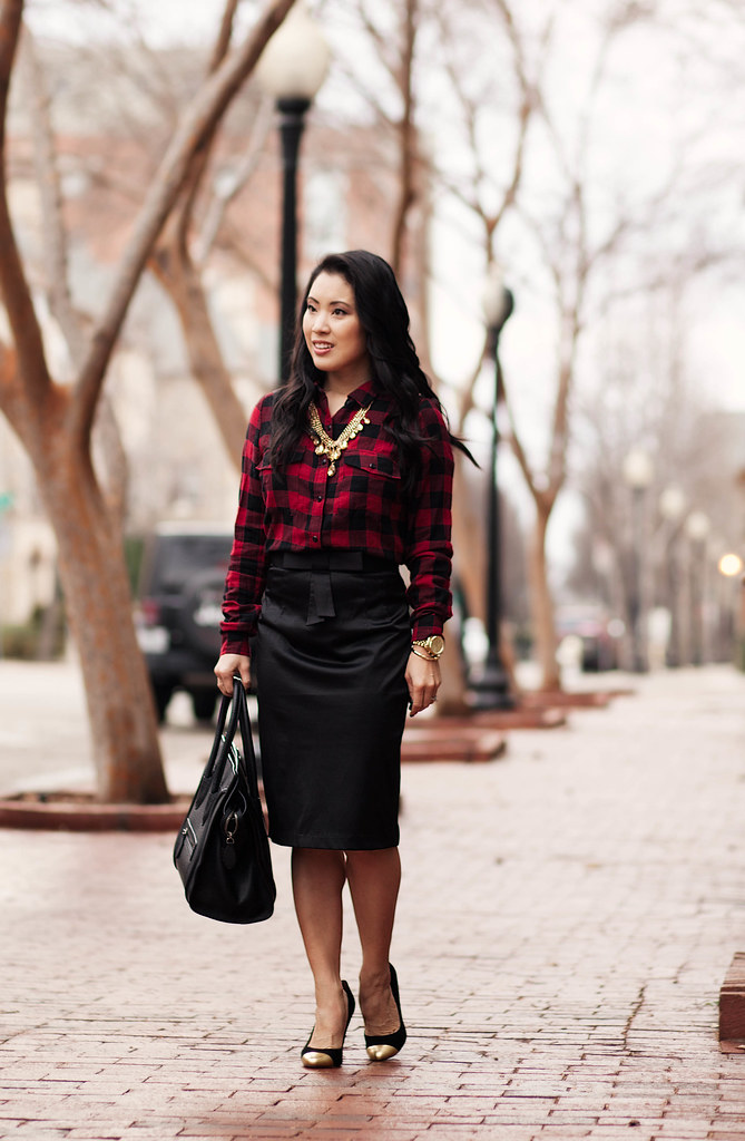 cute & little blog | dressing up buffalo plaid | buffalo plaid shirt, gold statement necklace, black satin pencil skirt outfit