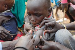 A child in Tirgol town receiving a measles vaccination