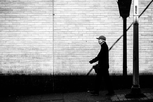 streetphotography seattle blackandwhite man shadows canon sidewalk wall bw internationaldistrict contrast urbandocumentary canon135mmf2lusm canoneos5dmarkiii johnwestrock
