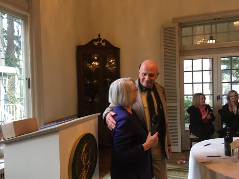 Tom Dent is congratulated by Rep. Ruth Kagi after presenting him the 'Spirit of June Leonard Award.'