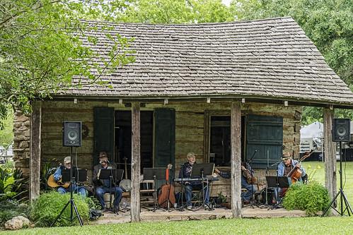 melroseplantation artsandcraftsfair nationalhistoriclandmark natchitoches louisiana bluegrassband zydeco cabin house porch
