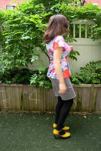 Side view of Cake Patterns Hummingbird Peplum Top—in hummingbird colors