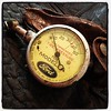 Found item:  Ford Model A tire pressure gauge and pouch.