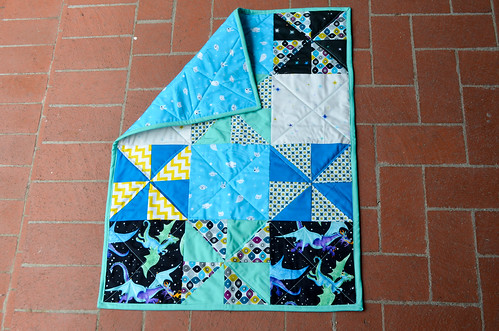 Baby quilt with pinwheels and dragons