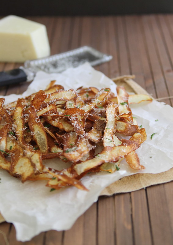 fried potato strips with parmesan cheese and rosemary
