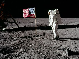 Neil Armstrong standing on the surface of the moon