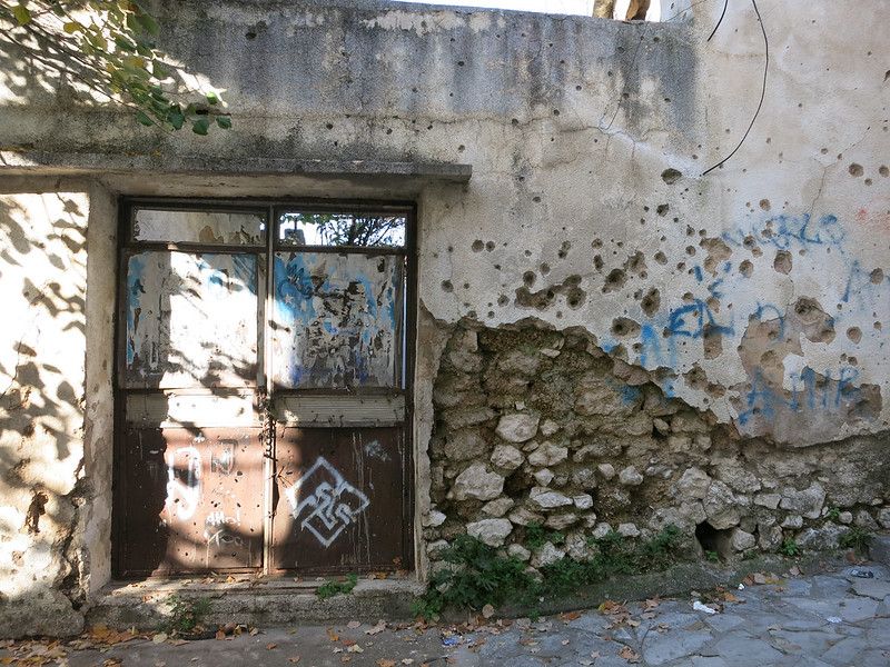 Bullet-ridden walls and doors.