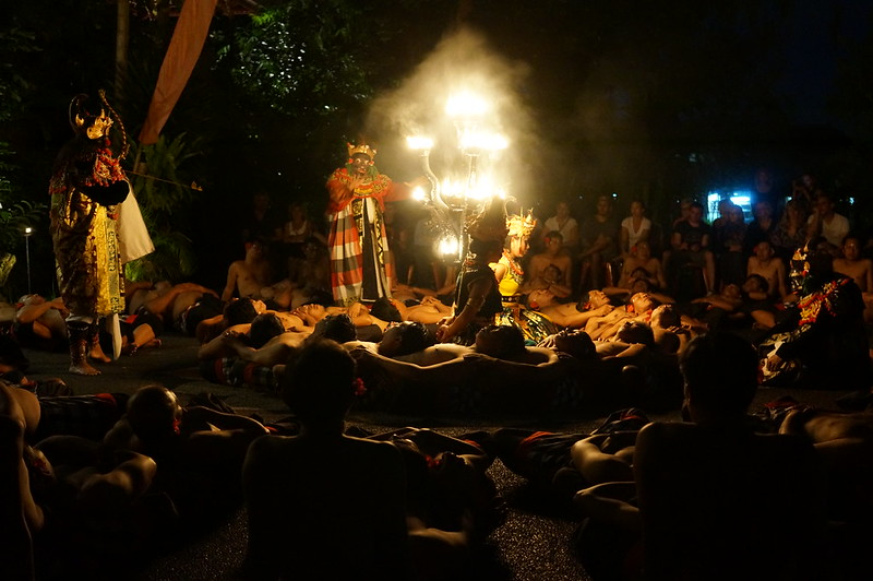 'Kecak Ramayana and Fire Dance' show - main performers surrounded by chanting men.