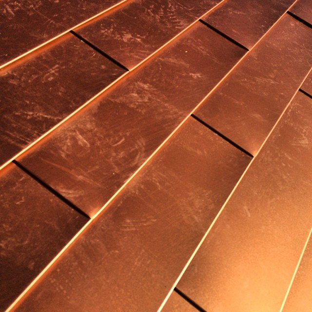 Copper! First floor roof with color colored metal tile.