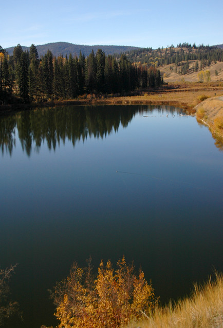 fall reflected on a lake in the hills above Merritt