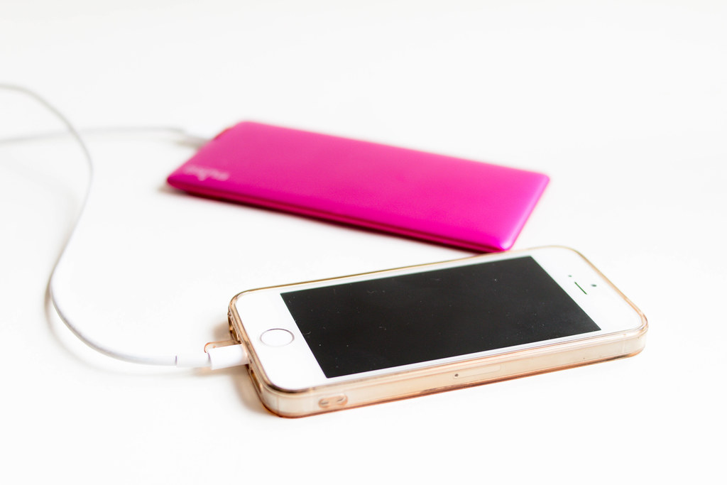 iPhone 5c with pink charger