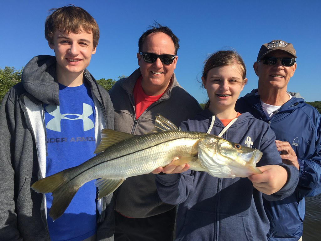 Happy family with a nice snook fishing with Tampafishingcharters.com