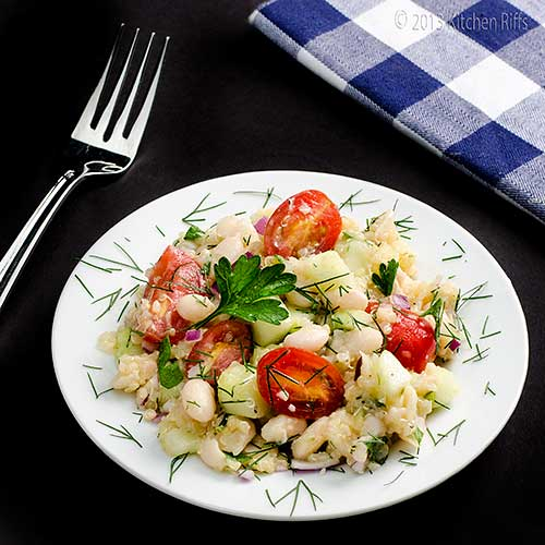White Bean and Quinoa Salad on plate, with fork and napkin