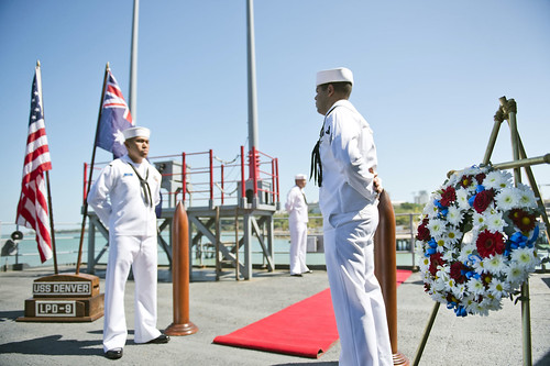 Chief petty officer selectees assigned to USS Denver honor sunken destroyer USS Peary (DD 226) with a wreath
