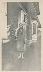 Woman in Native American costume poses outside