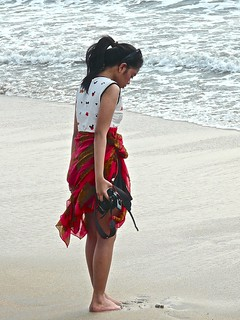 Beach girl with her camera .