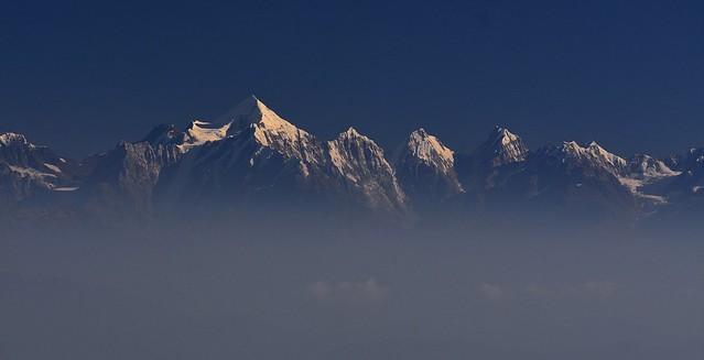 Panchachuli peaks towering above mist