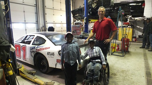 Thai Milton, his little brother and Dom Vetere of Dom's Auto Parts.