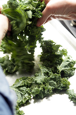 tossing kale for kale chips