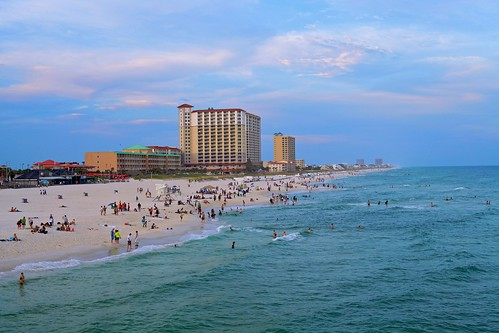 sunset people building green beach water canon evening shark pier pensacola pensacolabeach
