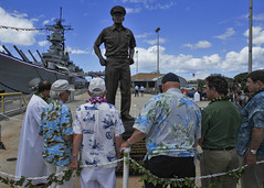 Several crew members who were aboard USS Missouri during the signing of the Instrument of Surrender and the artists that created the statue take part in a traditional Hawaiian blessing for the nine-foot bronze sculpture of Fleet Adm. Chester Nimitz. (U.S. Navy Photo by Mass Communication Specialist 2nd Class David Kolmel)