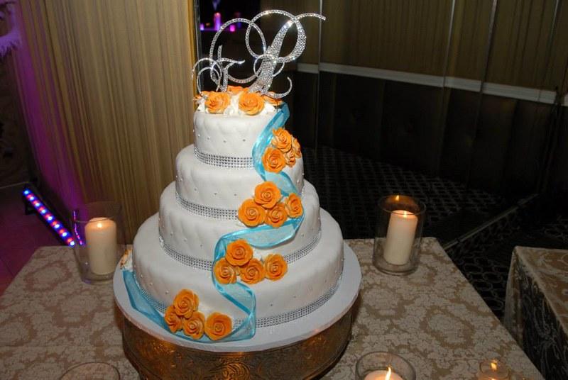 orange and turquoise wedding cake, crystal monogram cake topper
