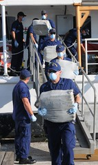 Crewmembers aboard Coast Guard Cutter Venturous, homeported in St. Petersburg, Fla., offloads $23 million worth of cocaine at Sector St. Petersburg Tuesday, Oct. 22, 2013. The crew returned with the contraband after a 40-day patrol in support of Operation Caribbean Guard. U. S. Coast Guard photo by Petty Officer 1st Class Crystalynn A. Kneen