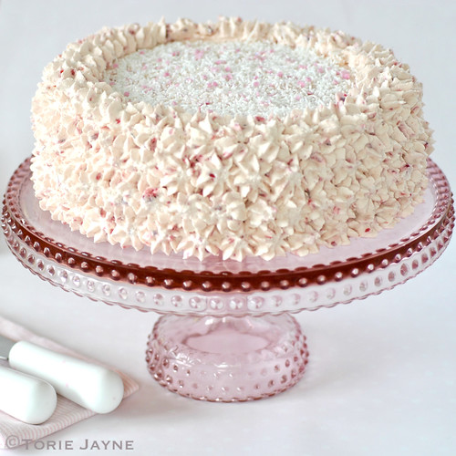 Pink pressed glass cake stand