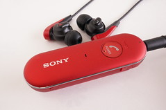 communication device(0.0), electronic device(1.0), red(1.0), headset(1.0), gadget(1.0), headphones(1.0),