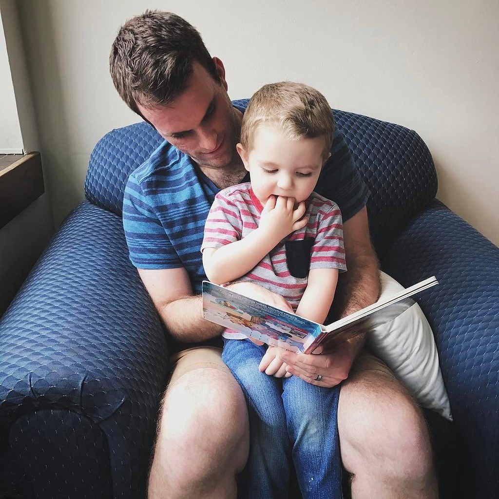 Uncle Clint came and visited us and Ezra demanded him read to him. // #ezrayuuto #boystownliving