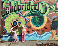 Squiggs and Zoe, Solidaridad! Mural in downtown Watsonville near Pumped.