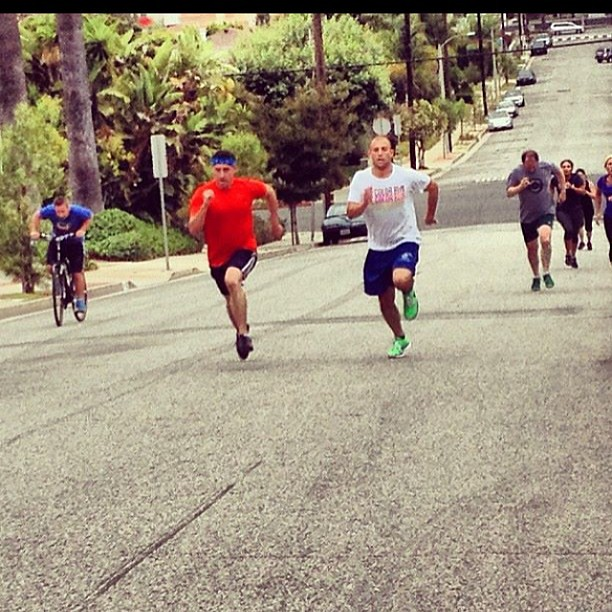 One of my fav pic's in a while. Franklin Hill sprints - and Butler on a bike! #sprints #crossfit #howwedo #ilovemybox
