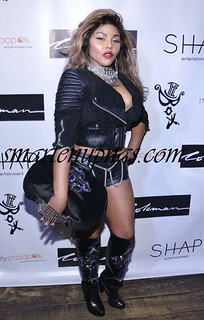 Whoa The Queen of hiphop Lil Kim Rocking some tight Pum Pum Shorts at a party .. damn she looks good