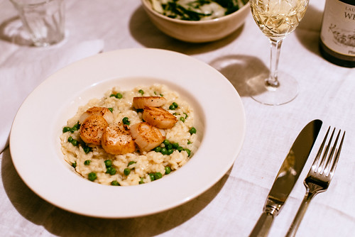 Risotto with peas and pan fried scallops.