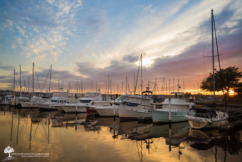 sunset storm reflection marina boats nikon colorful sailing docked moored d600 newbern stormysunset uprootedphotographer uprootedphotographercom newberngrandmarina afterstormsunset