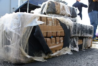 SAN DIEGO – Packages of cocaine seized by U.S. Coast Guard law enforcement teams sit on the deck of the guided-missile frigate USS Rentz before being offloaded in San Diego, March 3, 2014. Coast Guard teams operating aboard Coast Guard cutters and both U.S. and Canadian Navy ships in the Eastern Pacific Ocean interdicted the nearly four tons of narcotics during nine separate at-sea interdictions. U.S. Coast Guard photo by Petty Officer 3rd Class Connie Terrell.