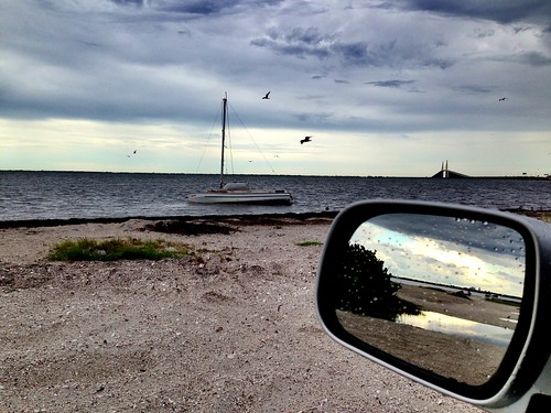 View in side mirror:  #StPete, beached boat and Sunshine Skyway Bridge #TampaBay @VSPC