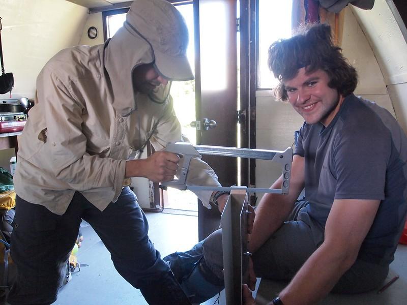 Piortr and Julien working on the door shoe