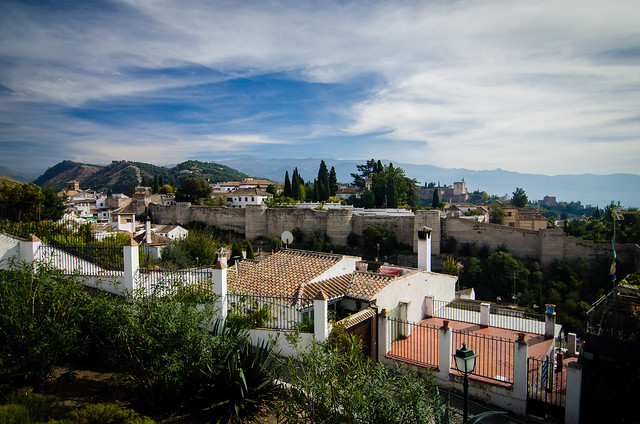 The, slightly obstructed, view of the Alhambra as seen from the San Cristobal Mirador in Granada, Spain.