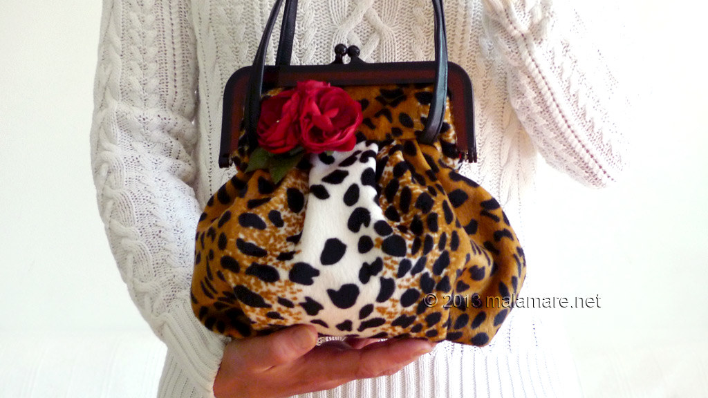 velvet handbag with leopard pattern handles