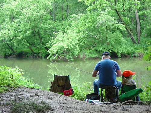 Young girl fishing with grandfather at Gunpowder Falls State Park