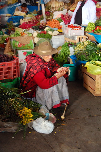 Old woman selling food in Cusco
