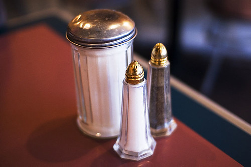 The image shows a salt and sugar shaker.