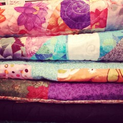 5 quilts trimmed and ready to bind for #TheLinusConnection. #blanketcharity #assemblylinequilting