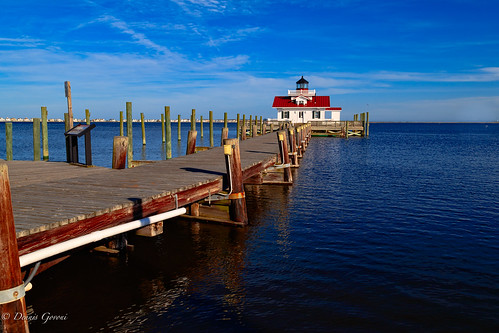 beach clouds landscape lighthouse manteo northcarolina outerbanks water unitedstates us