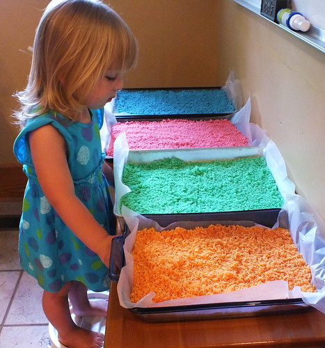 Phoebe can't wait to play with the colored rice!